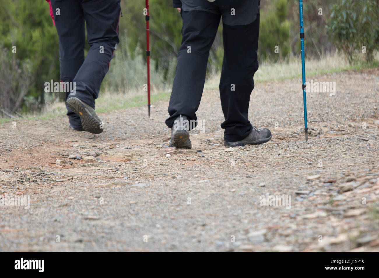 Walking, trekking or maybe goin hiking in the mountains - Stock Image