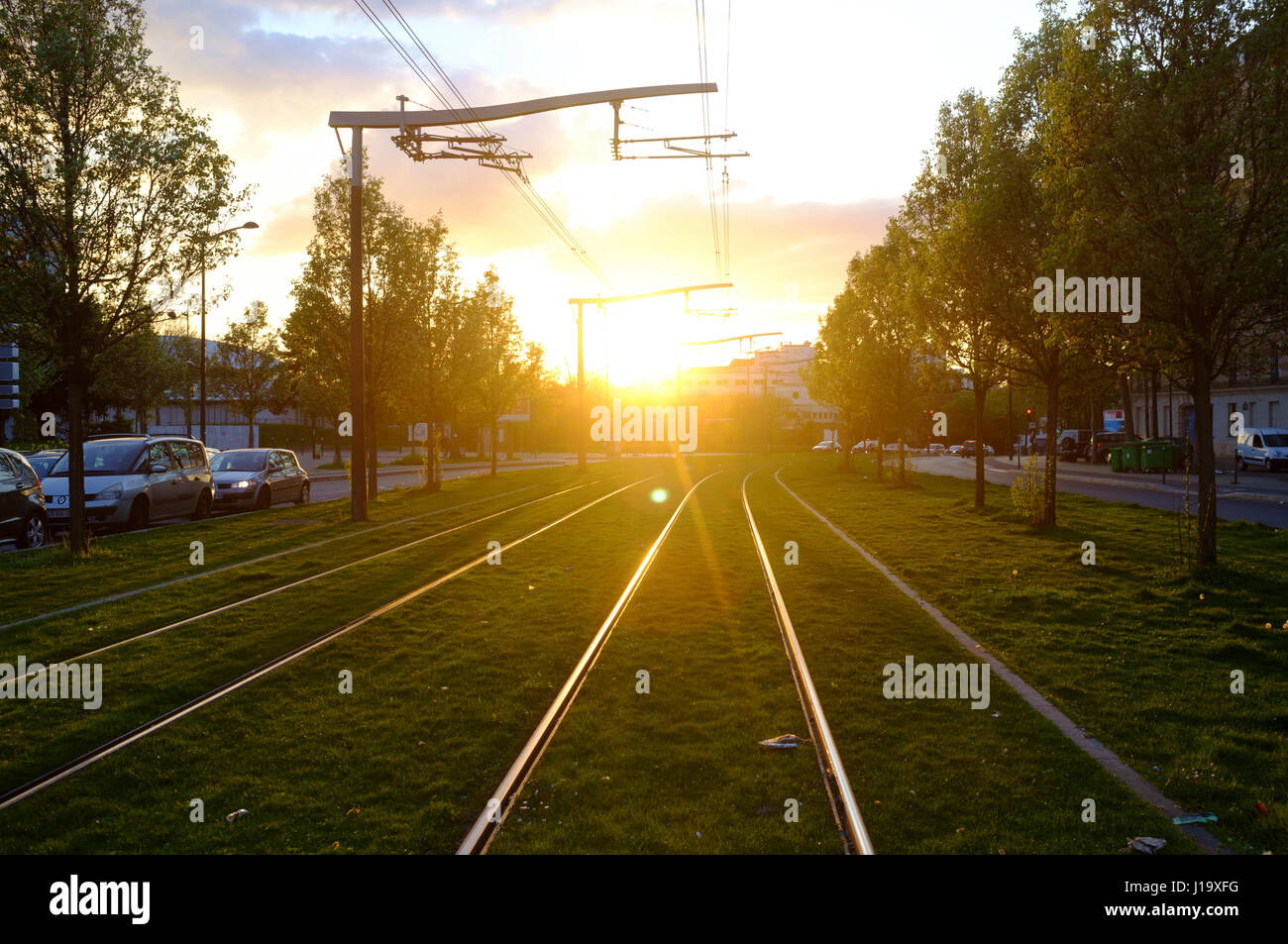 Sunset view of gleaming tracks of a Tramway, Paris - Stock Image