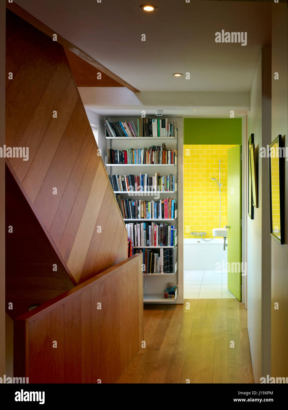 Stair, Bookcase, Bathroom. Ellingford Rd, London, United Kingdom.  Architect: Cassion Castle Architects, 2012.