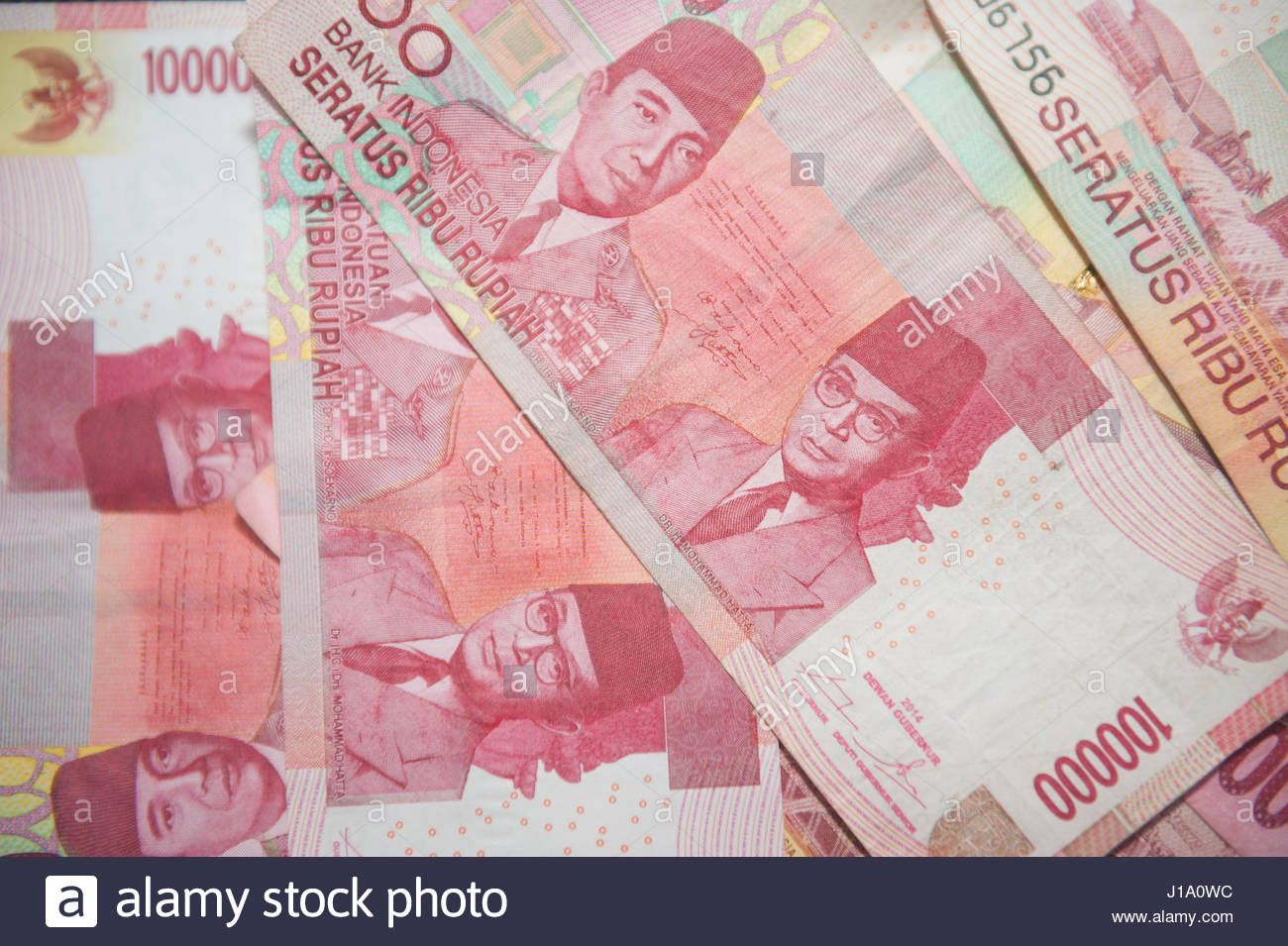 Indonesian banknotes depicting Soekarno and Mohammed Hatta. - Stock Image