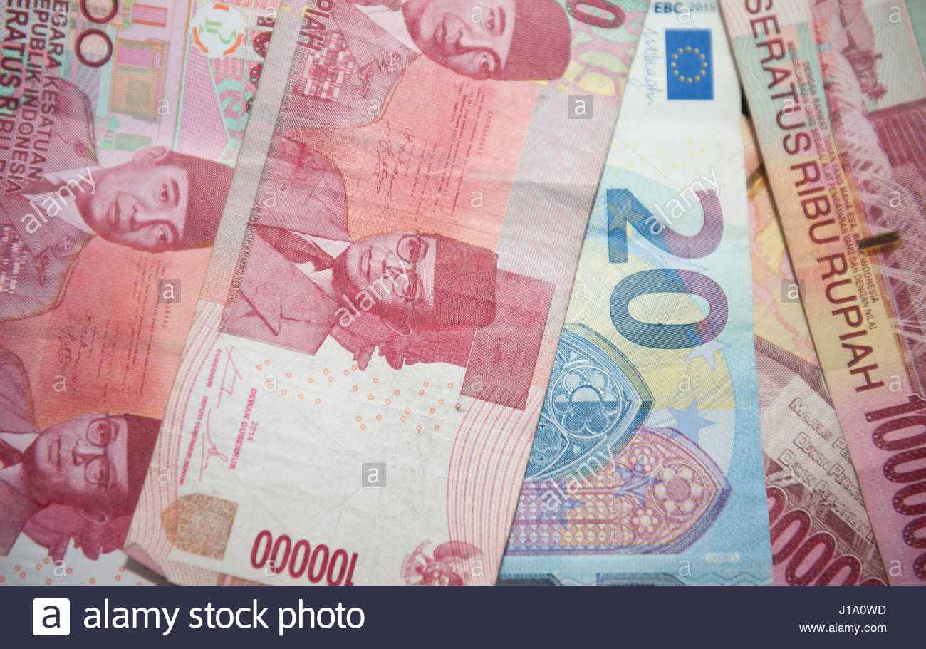 Indonesian banknotes with €20 note. - Stock Image