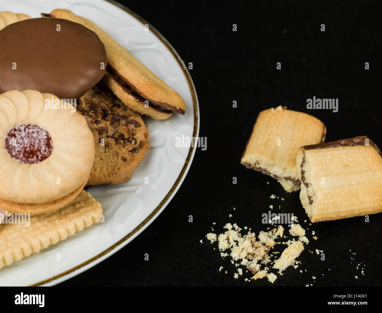 Selection of Teatime Biscuit Snacks Served on a Plate - Stock Image