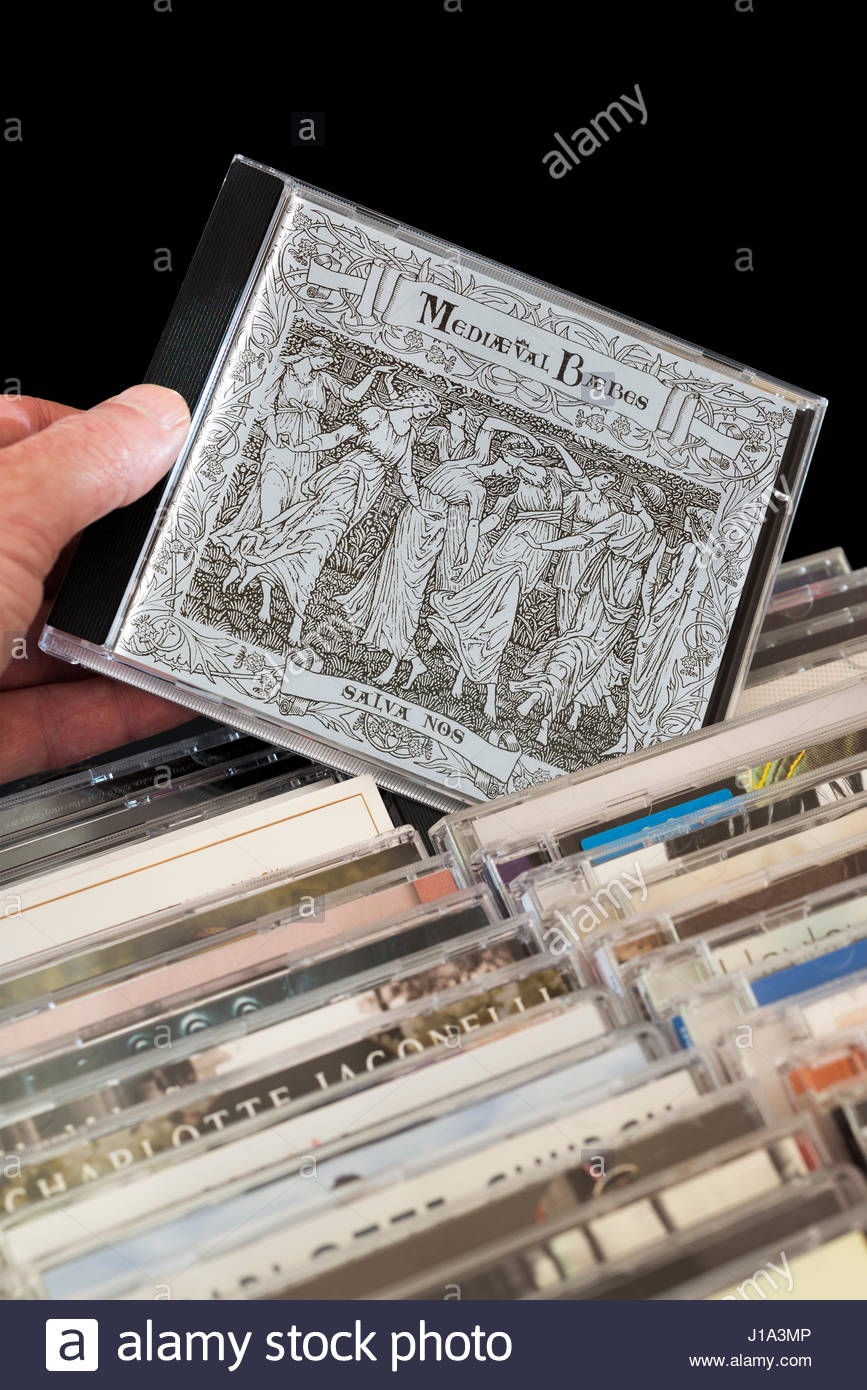 Salva Nos, 1998 Mediaeval Baebes debut CD being chosen from among rows of other CD's, Dorset, England - Stock Image
