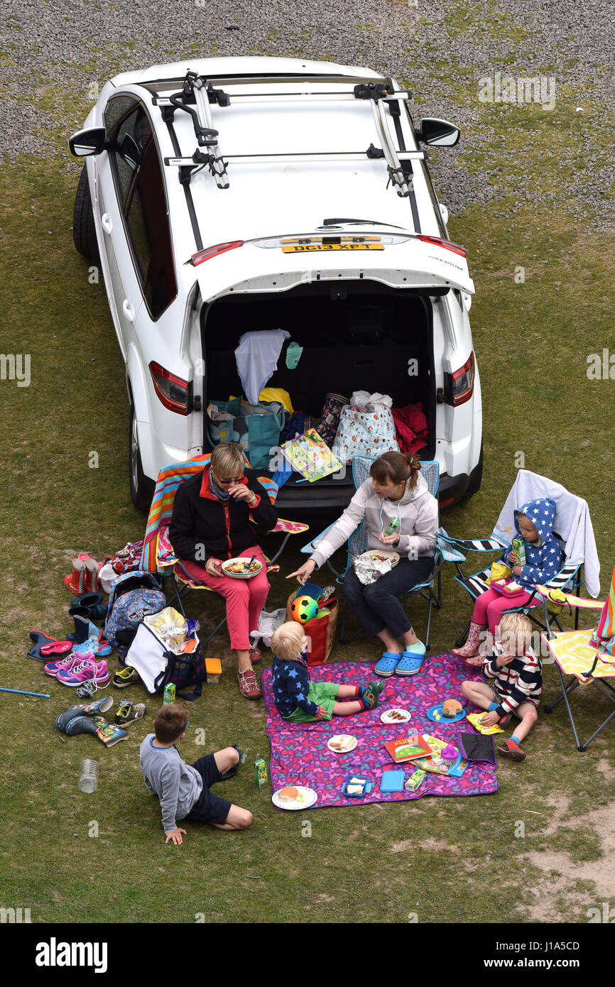 Family picnic in Carding Mill Valley in Shropshire Uk Stock Photo