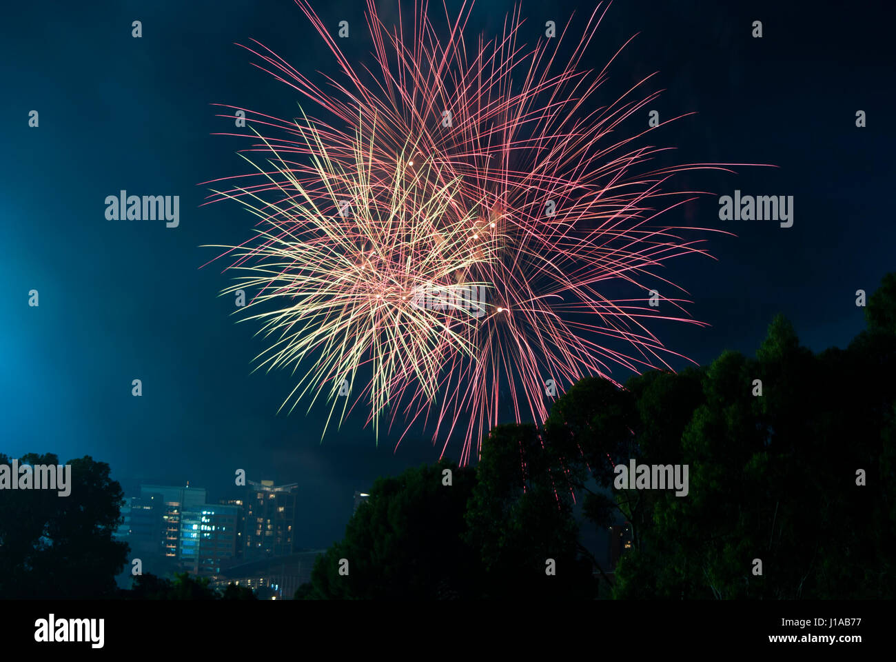 Fire works over the city of Adelaide's CBD, South Australia on New Years Eve from Montefiore Hill by the Lights - Stock Image