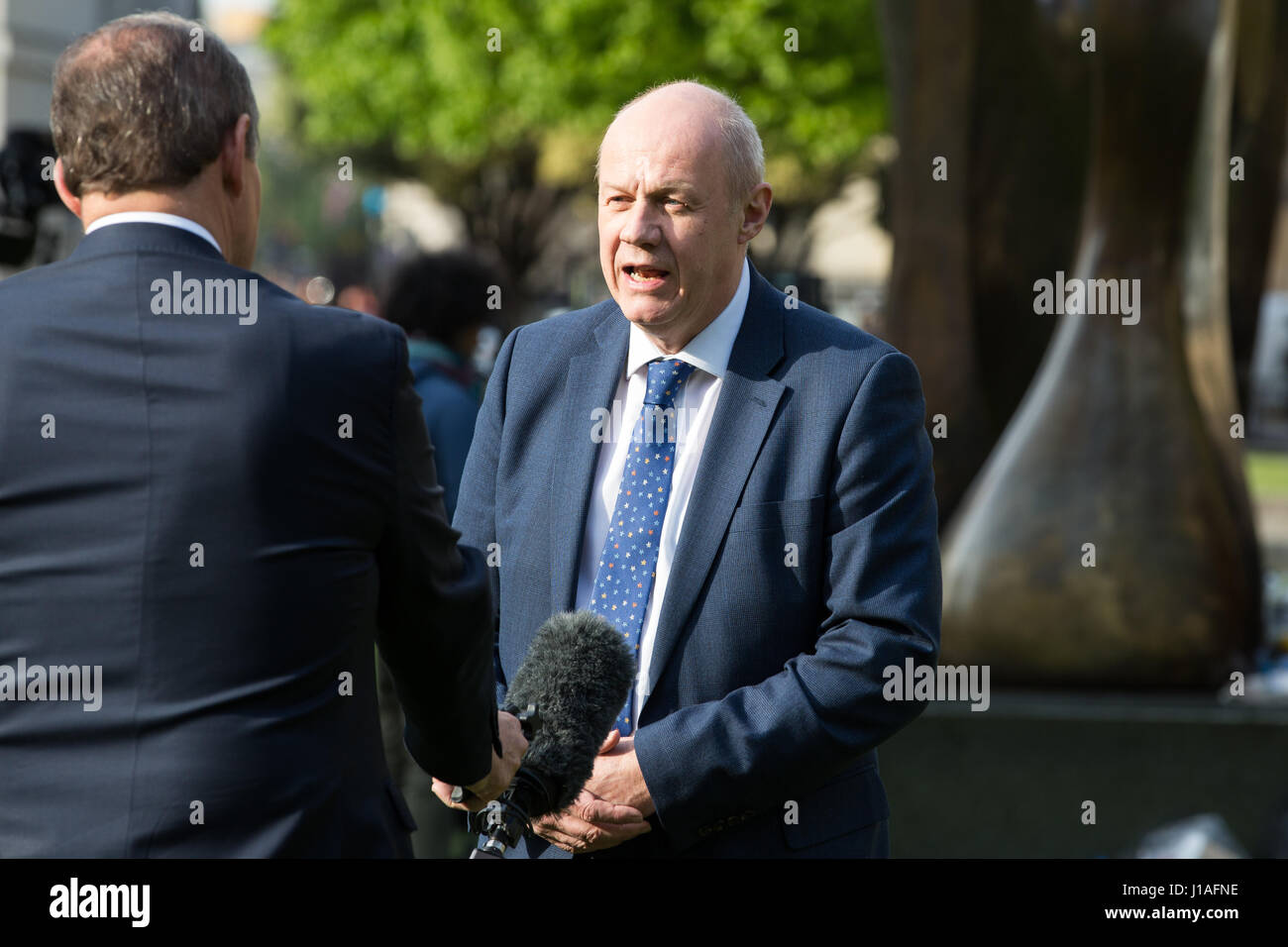 London, UK. 19th April, 2017. Damian Green MP, Work and Pensions Secretary, is interviewed on College Green following - Stock Image