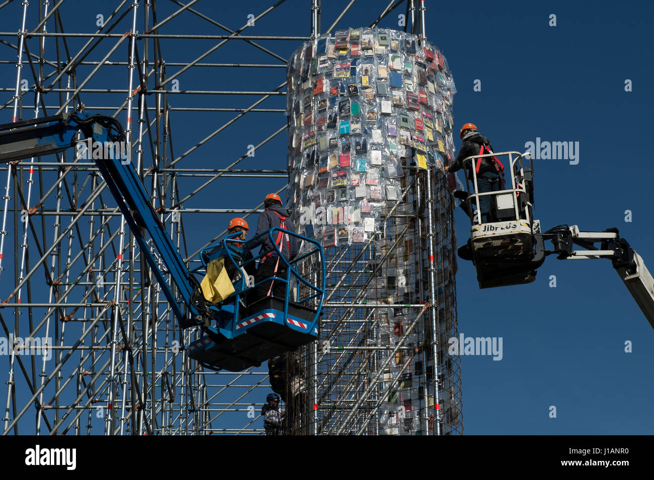 Kassel, Germany. 20th Apr, 2017. Books wrapped in plastic are attached to the steel scaffolding of the documenta Stock Photo