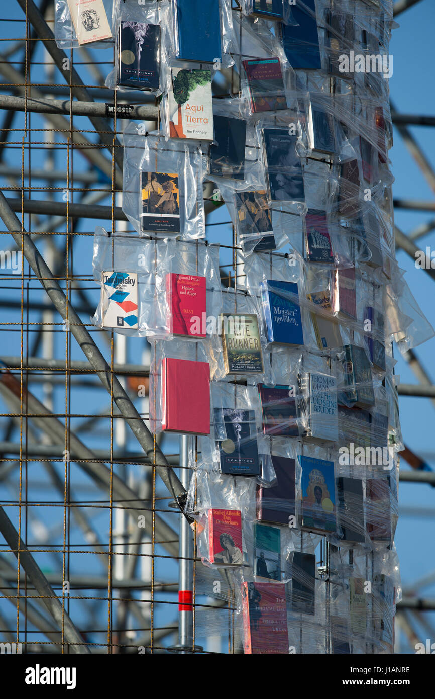Kassel, Germany. 20th Apr, 2017. Books wrapped in plastic hang on the steel scaffolding of the documenta artwork Stock Photo