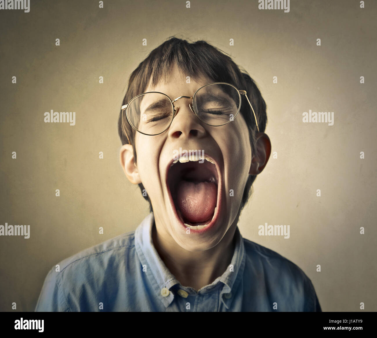 young boy screaming stock photo 138536701 alamy