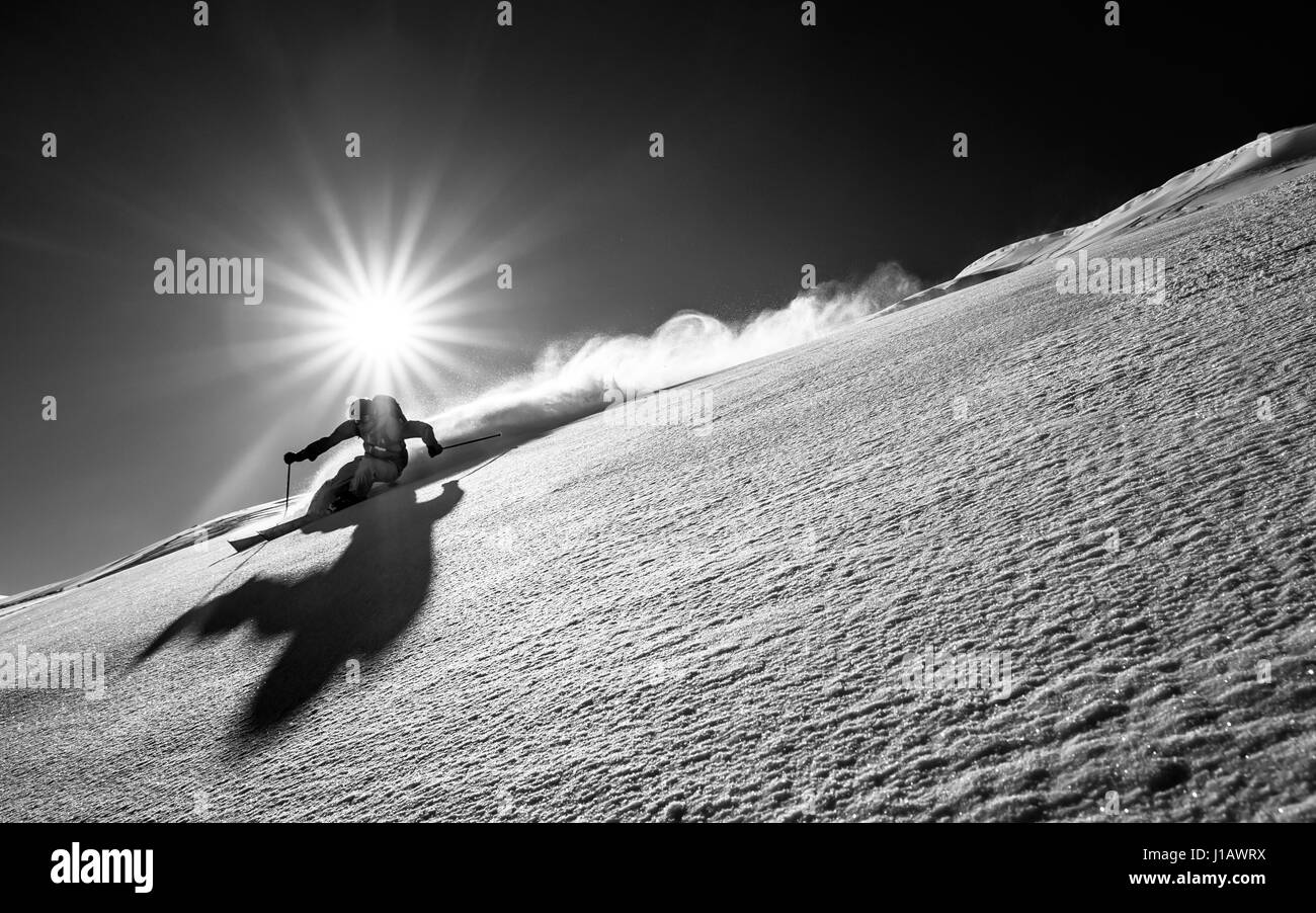 A skier does freestyle skiing on the Falkert Mountain in the Nockberge region in Carinthia, Austria. - Stock Image