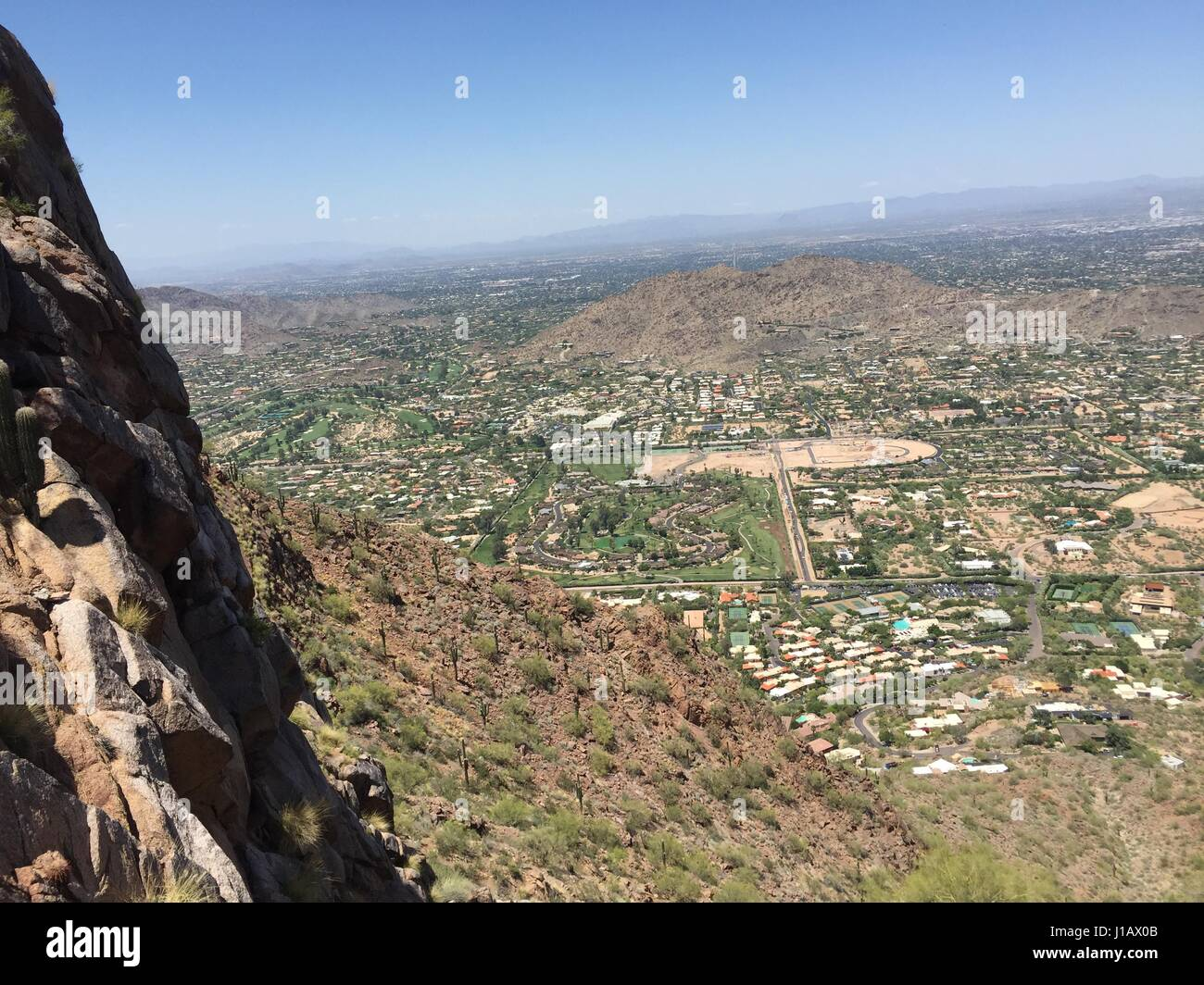 Halfway up Camelback looking out over Scottsdale AZ - Stock Image