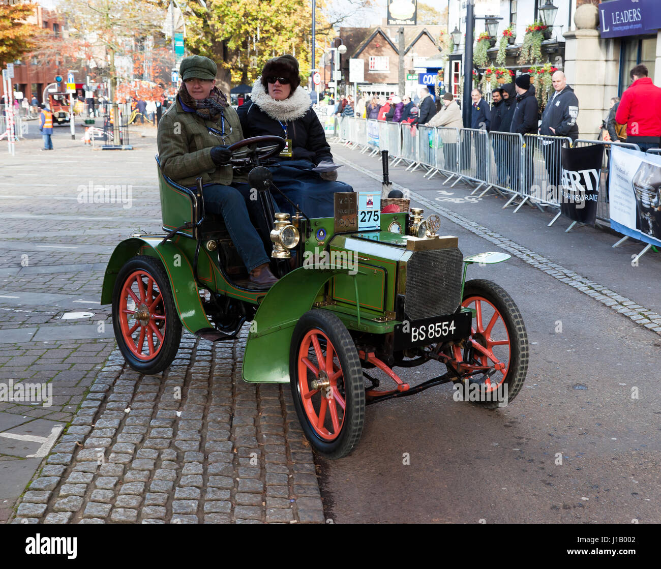 A 1904 Two-seater Peugeot, Driven by Mr William Madcalf, passes through Crawley High Street, during the 2016 London - Stock Image