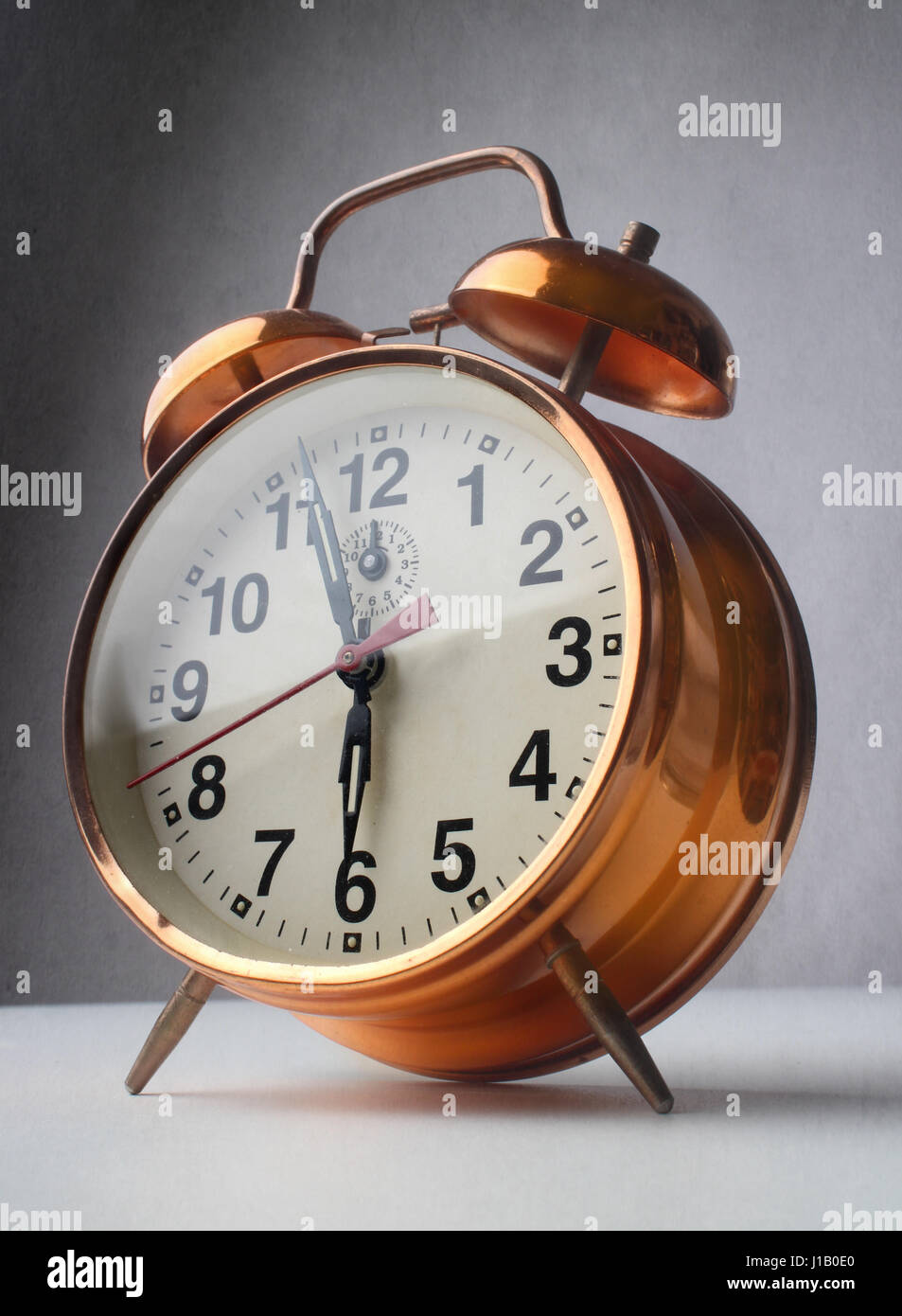 Picture of clock at 6am - Stock Image