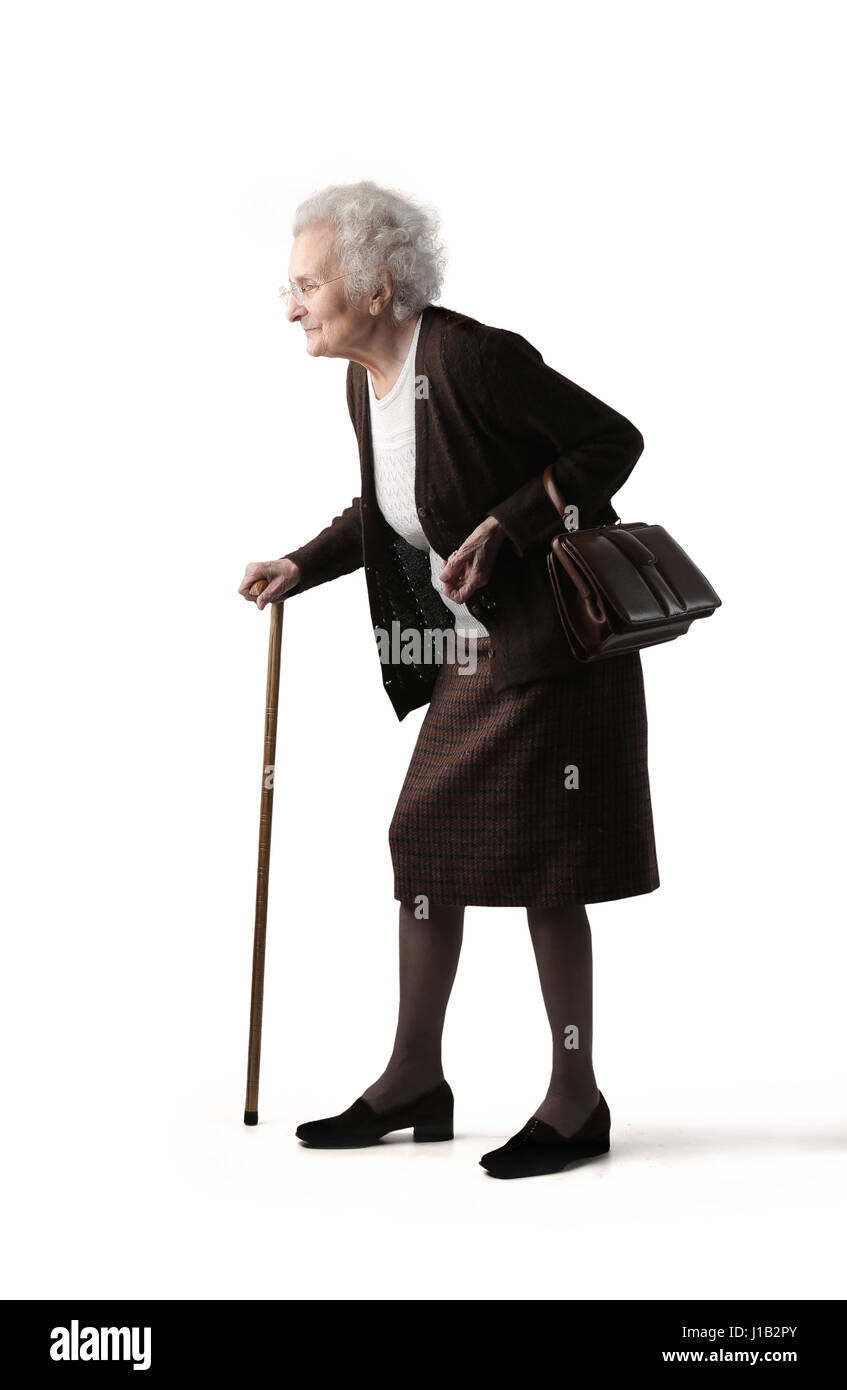Old lady walking with stick - Stock Image