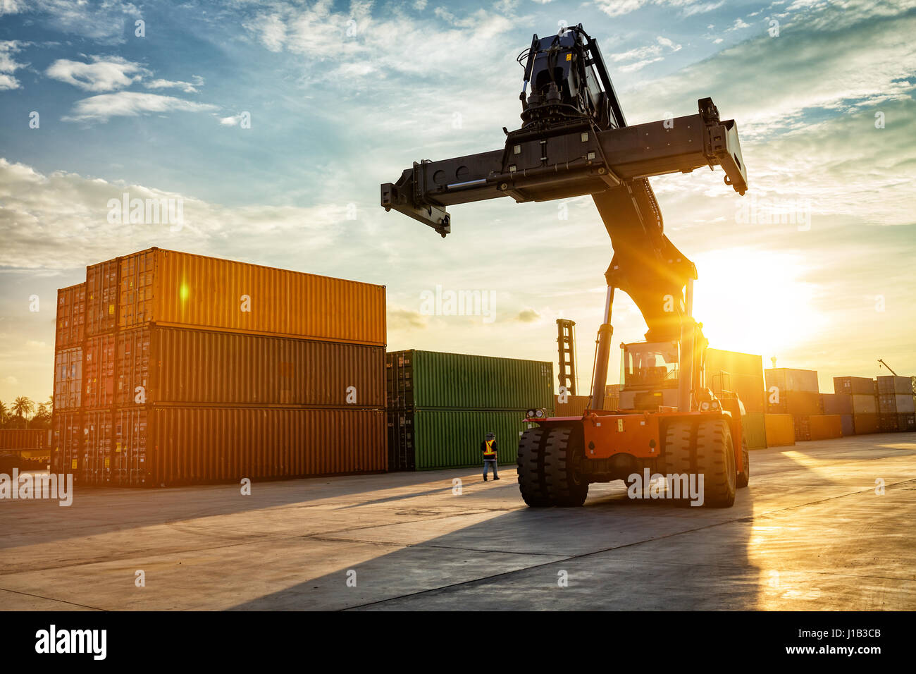 Thailand Laem Chabang Chonburi Industrial logistic forklift truck containers shipping cargo in port at sunset time. - Stock Image