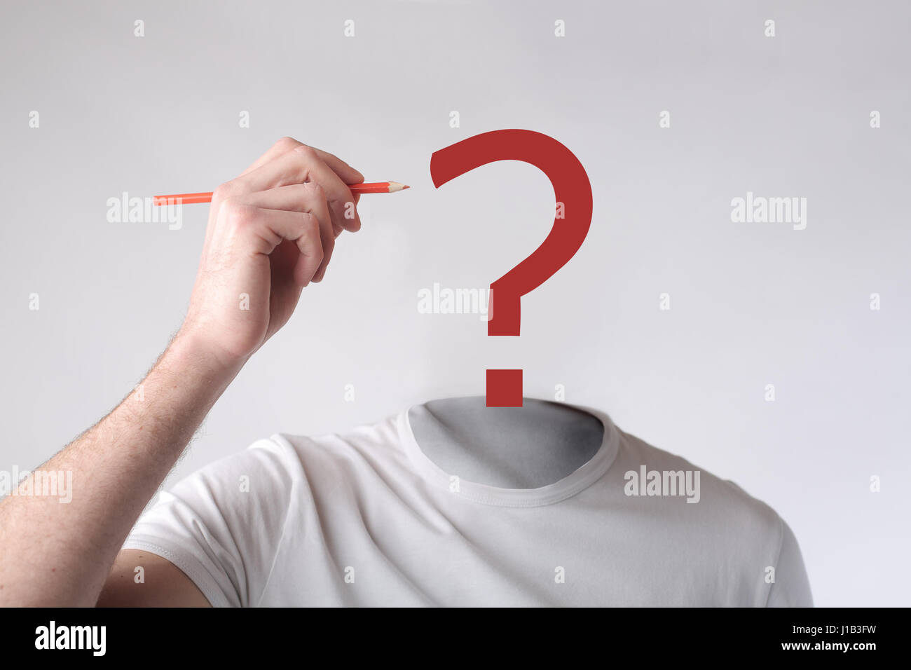 Headless man with a question mark on his head - Stock Image