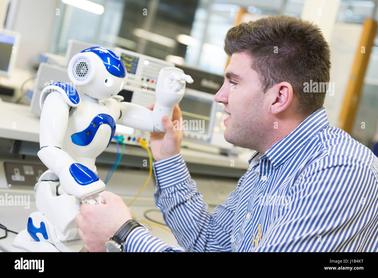 A Science Laboratory With A Scientist Investigating Robotics Stock