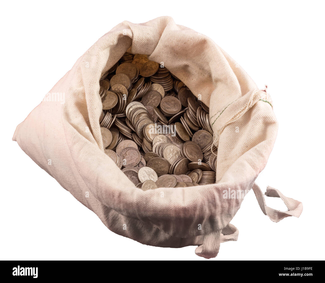 A sack of money with thousands of US dimes and coins in a cloth money bag with a white background. - Stock Image