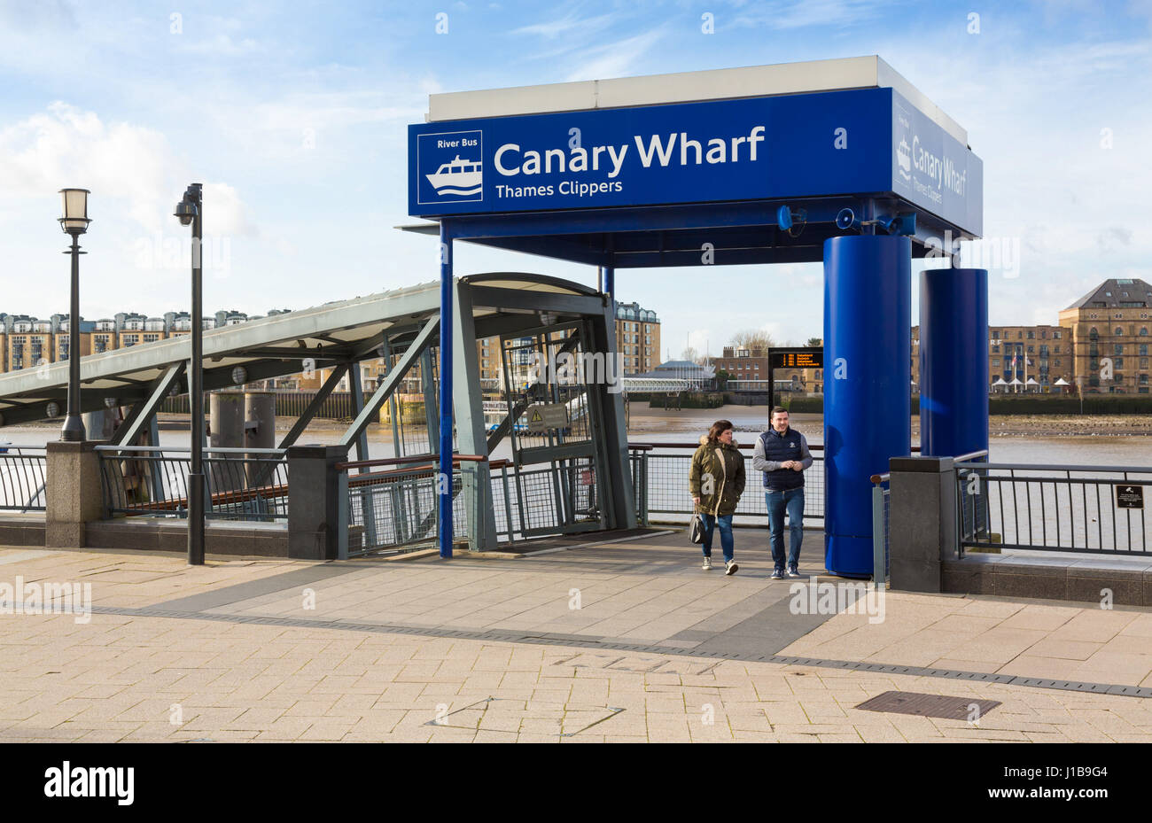 Thames Clippers ferry terminal on the River Thames in Canary Wharf, Docklands, London, England - Stock Image