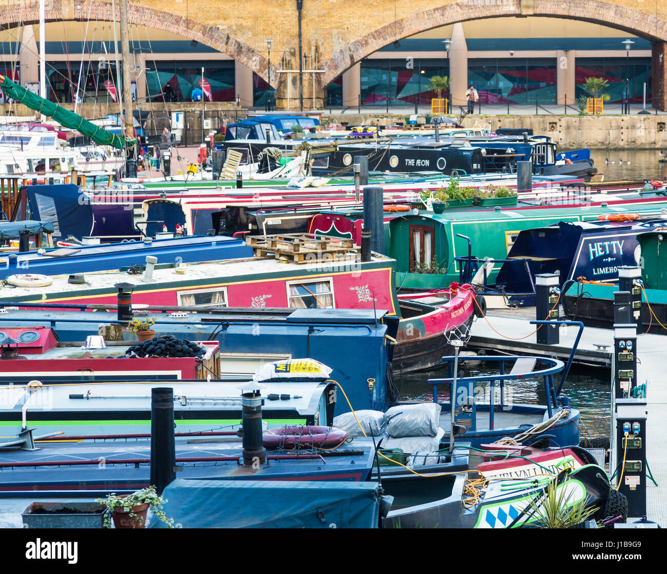 Barges and houseboats in Limehouse Basin Marina in Docklands, East End of London, England - Stock Image