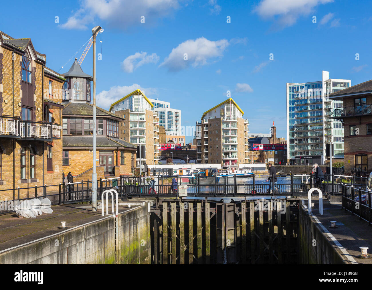 Lock gates into canal leading to Limehouse Basin Marina in Docklands, London, England - Stock Image