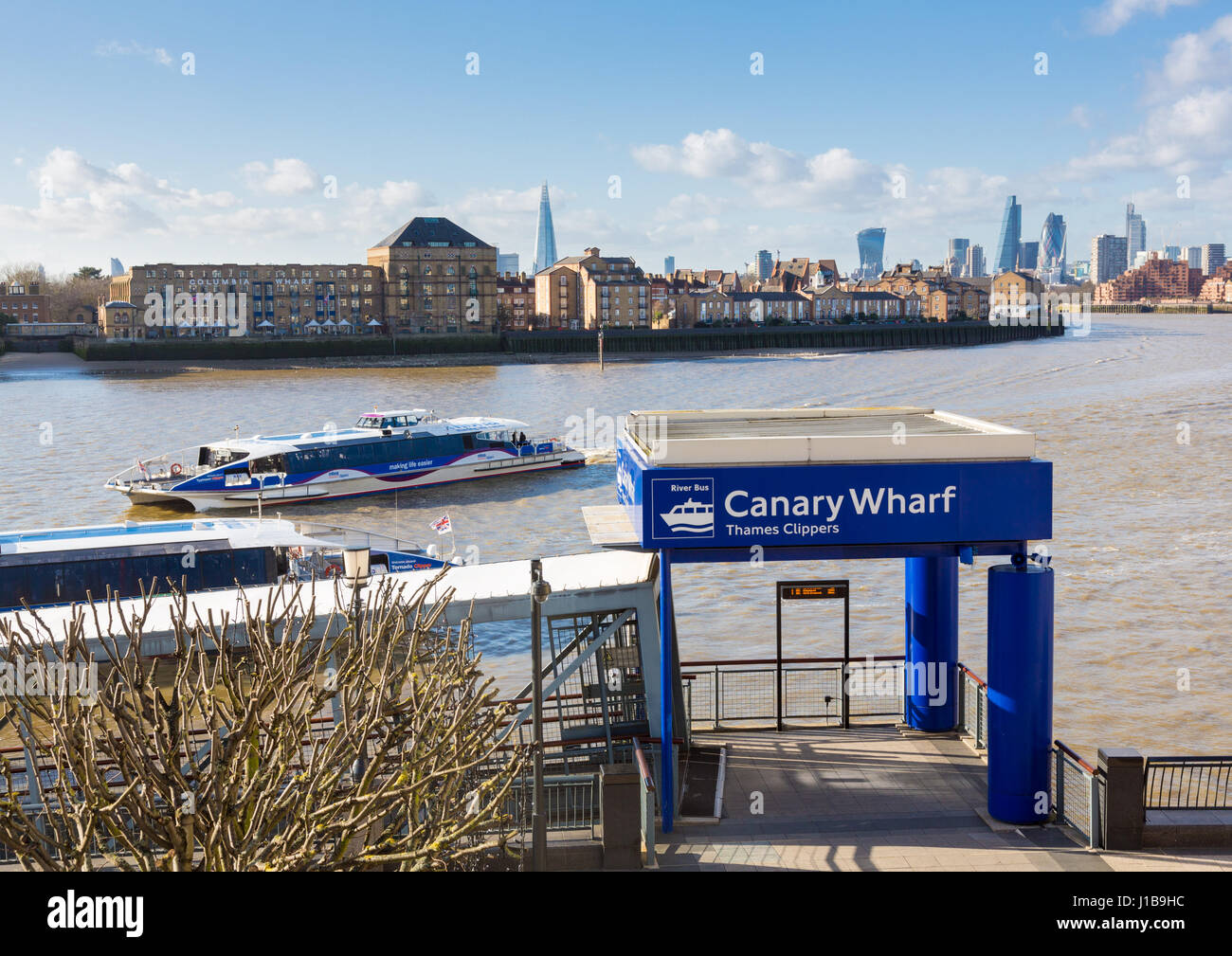 Thames Clippers ferry terminal on River Thames in Canary Wharf, Docklands, London, England - Stock Image