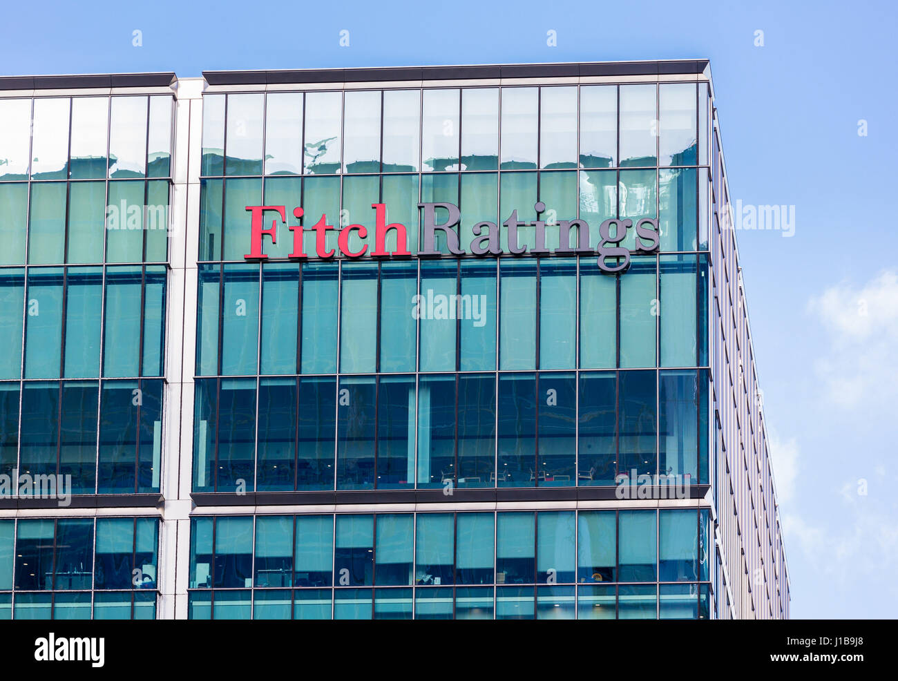 Fitch Ratings Agency logo on their building in Canary Wharf, Docklands, London, UK - Stock Image