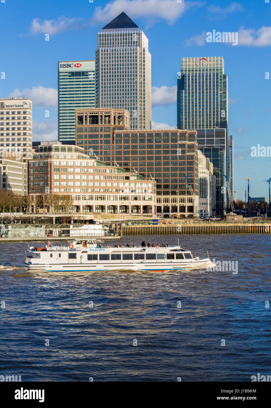 Thames River cruise boat and Canary Wharf, Docklands, London, UK - Stock Image