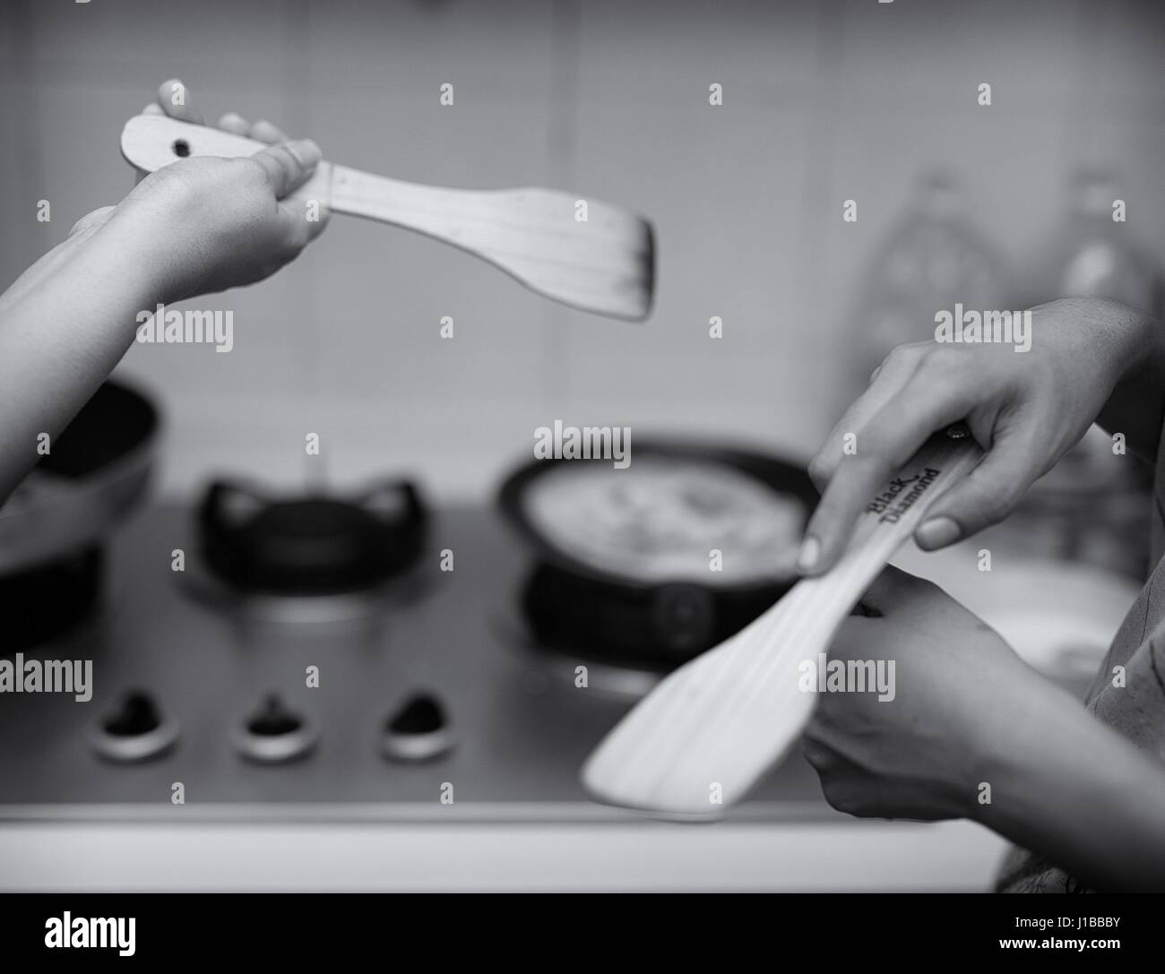 Home cooking (hands) - Stock Image