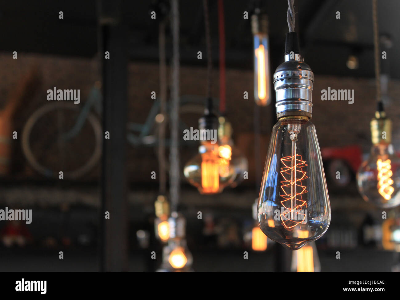 Decorative light bulbs on beautiful background - Stock Image