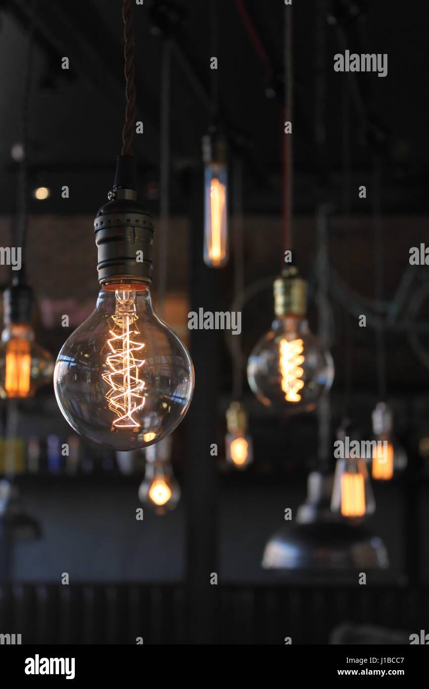 Edison light bulbs on beautiful background - Stock Image