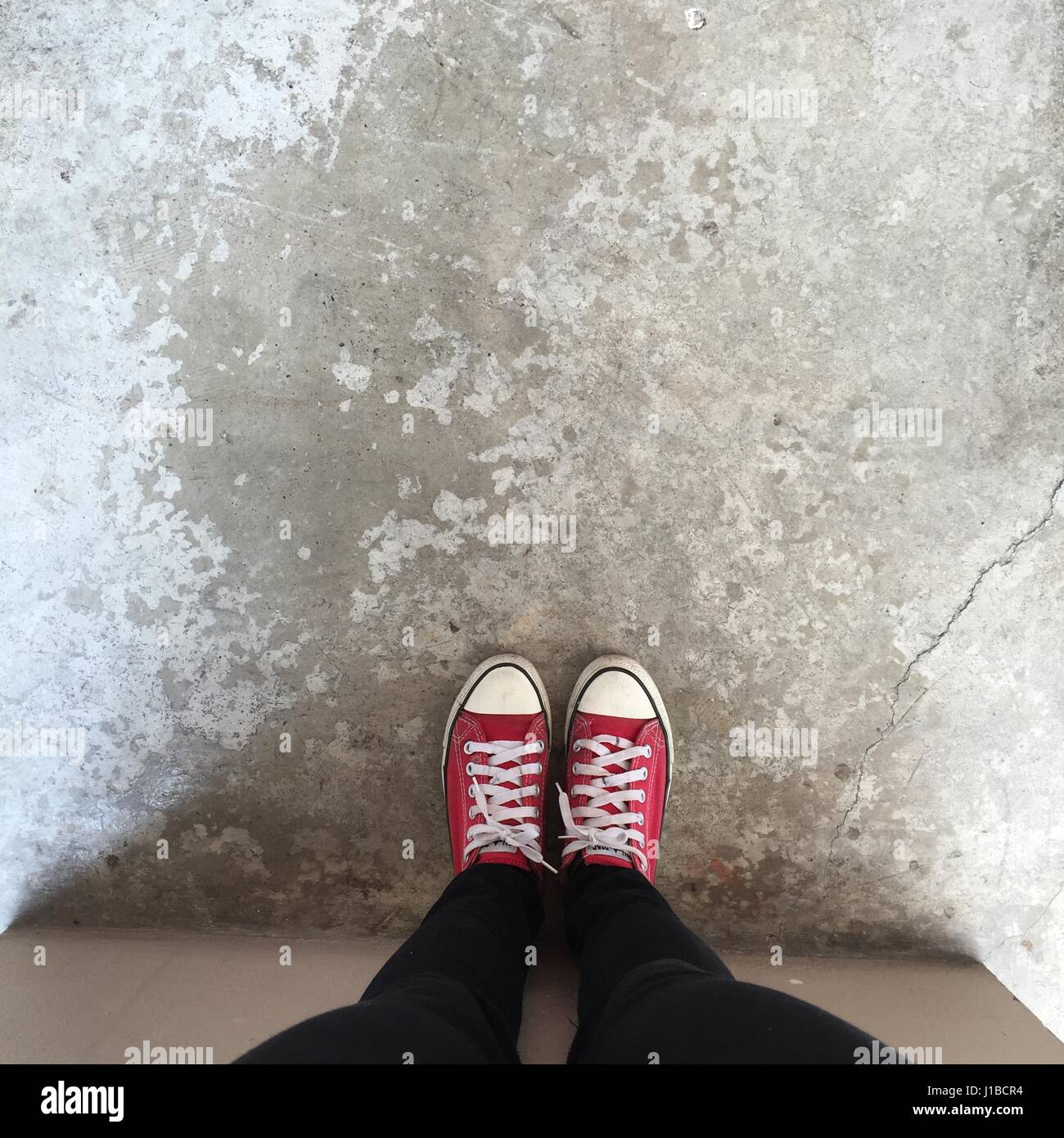 76cff096a4aa0e Feet From Above Concept, Teenage Person in Red Sneakers Standing on  Background Great For Any