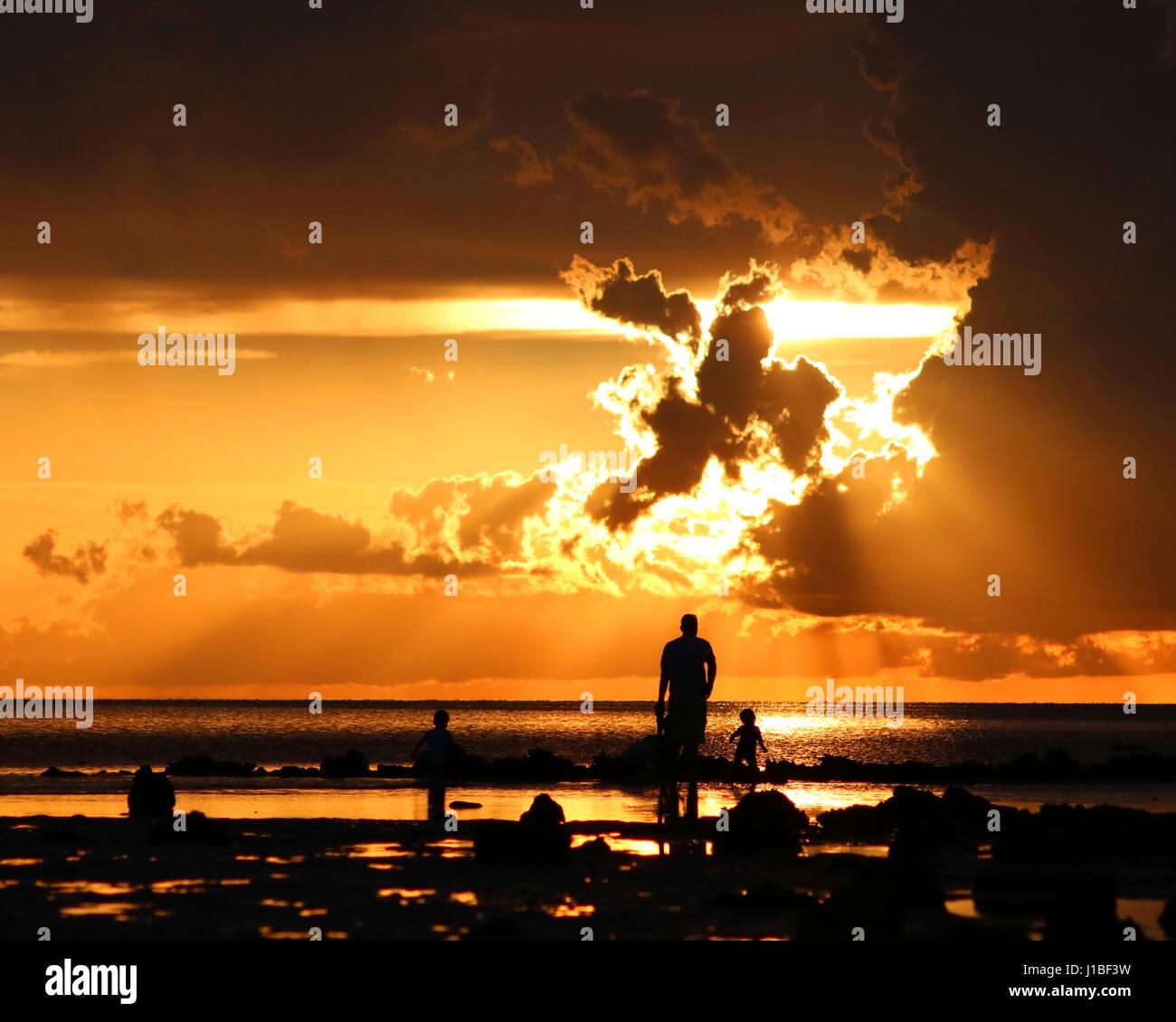 Family time Florida sunset - Stock Image