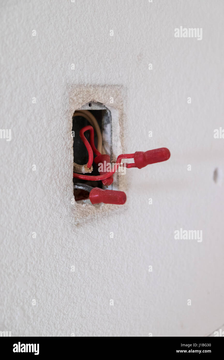 Electrical wires exposed in a junction box during a major house ...