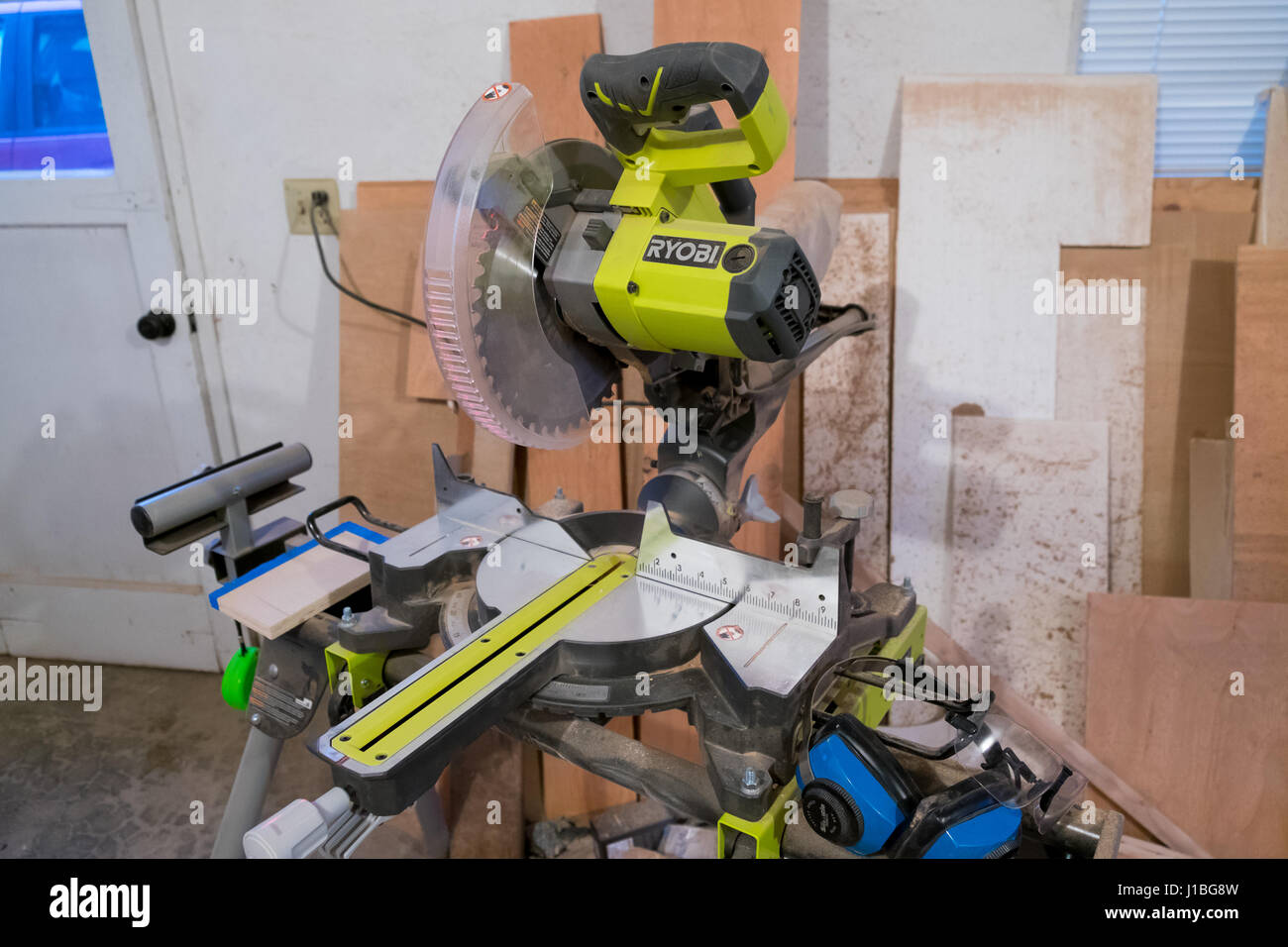 SPRINGFIELD, OR - JANUARY 31, 2017: Ryobi compound miter saw in a cutting shop during a major house renovation construction - Stock Image