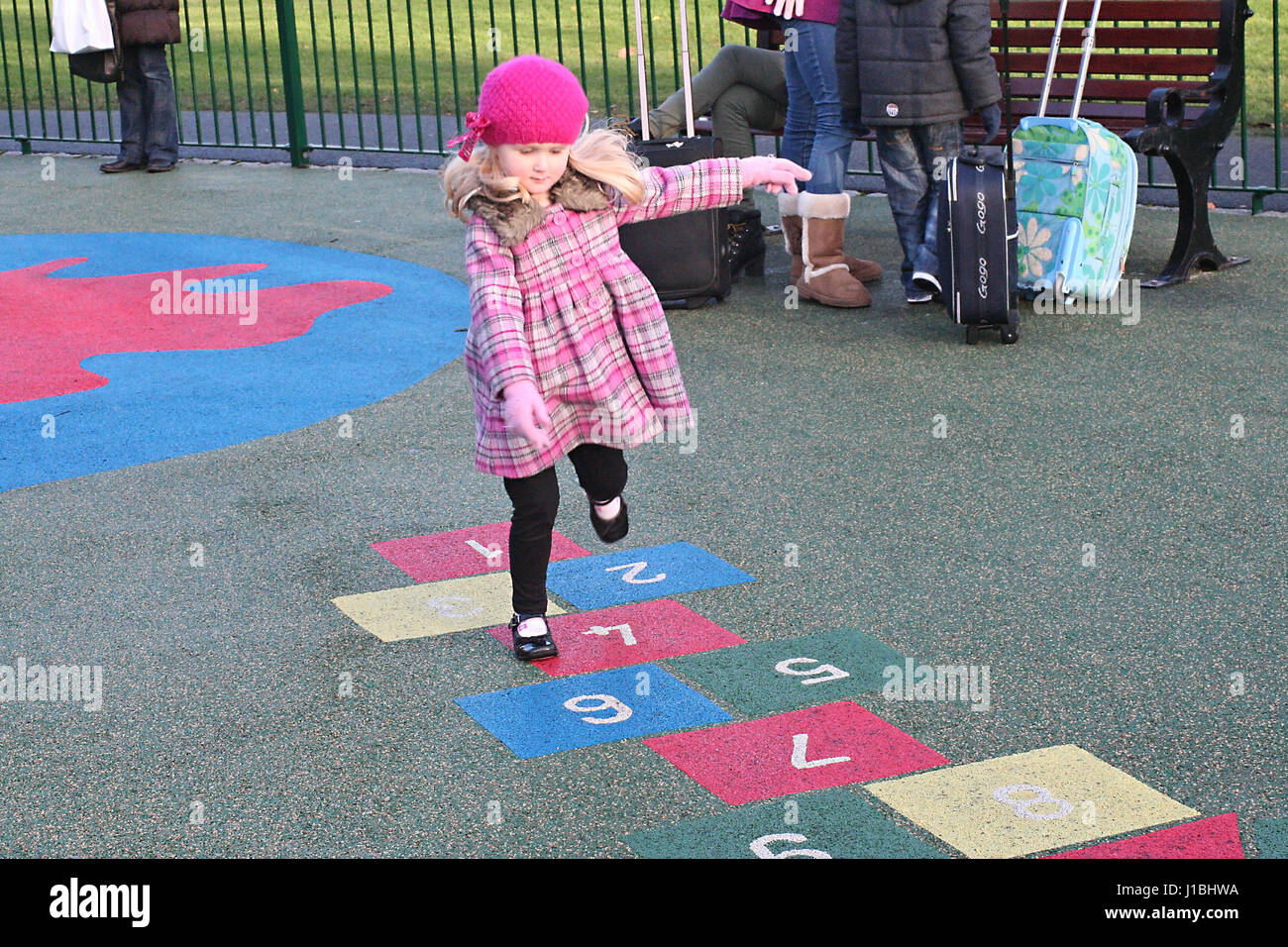 Little girl, child playing hopscotch in the playground in Stephen's Green Dublin Ireland kids playing playground Stock Photo