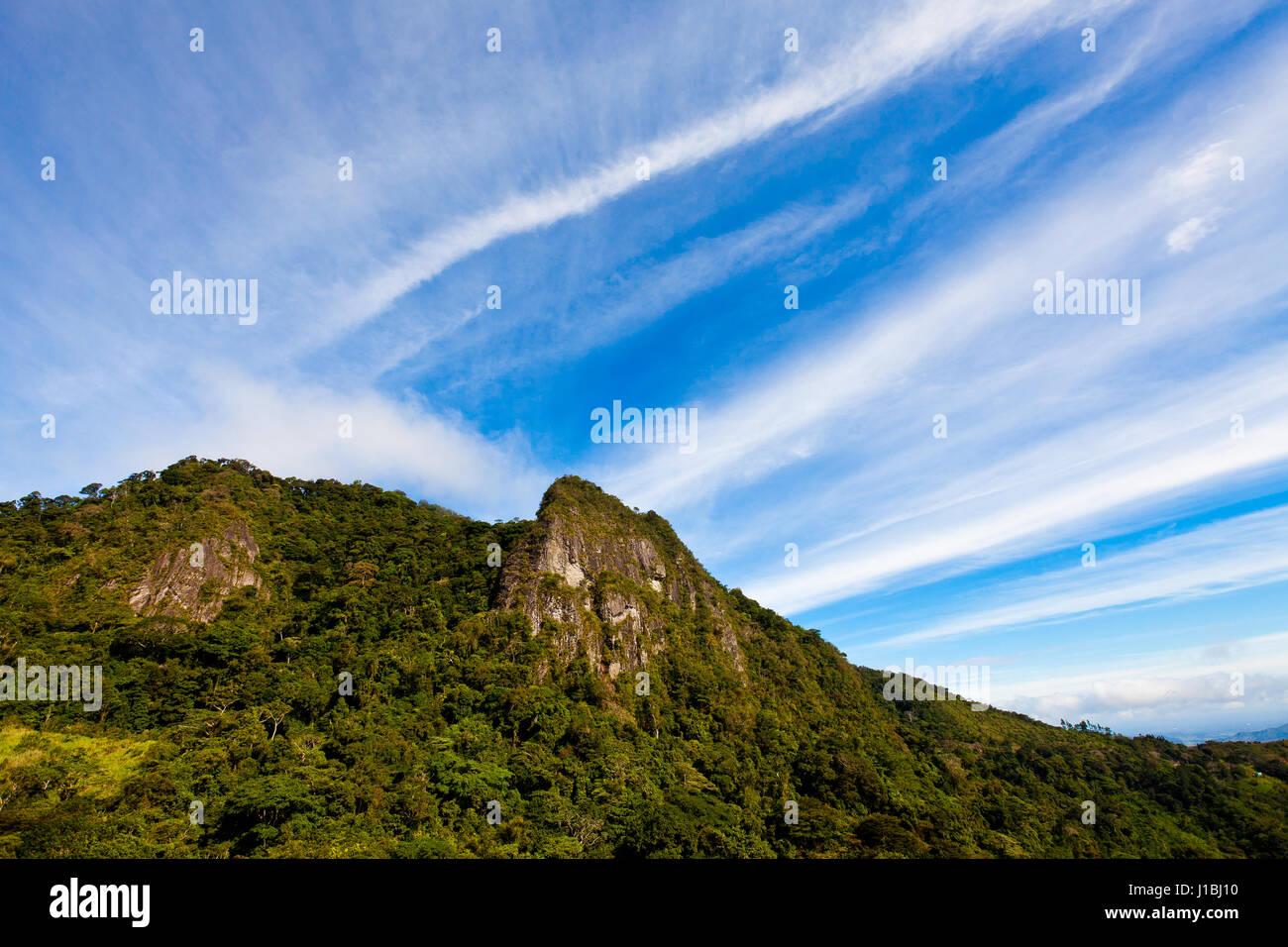 Beautiful skies over Cerro la Cruz in Altos de Campana National Park, Republic of Panama. Stock Photo