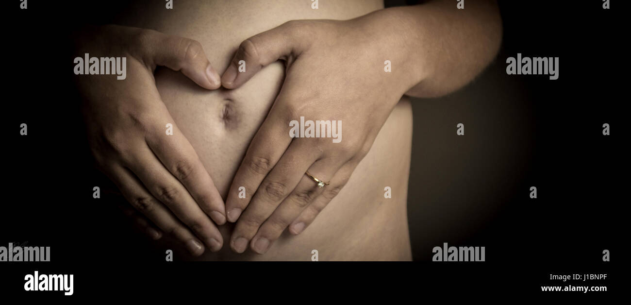 In the womb. Maternity photo shoot - Stock Image