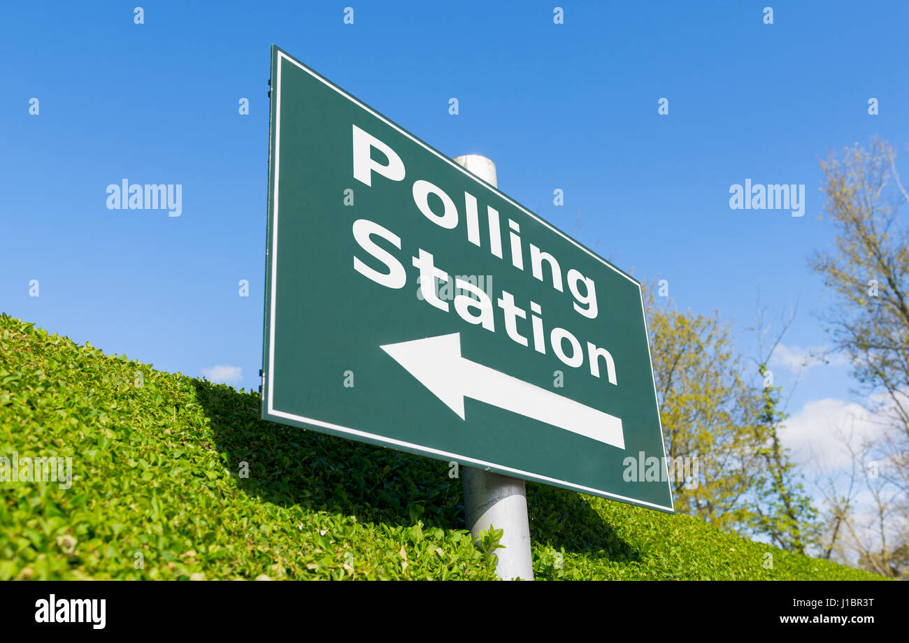 Signpost showing the direction of a Polling Station in order to vote in an election. - Stock Image