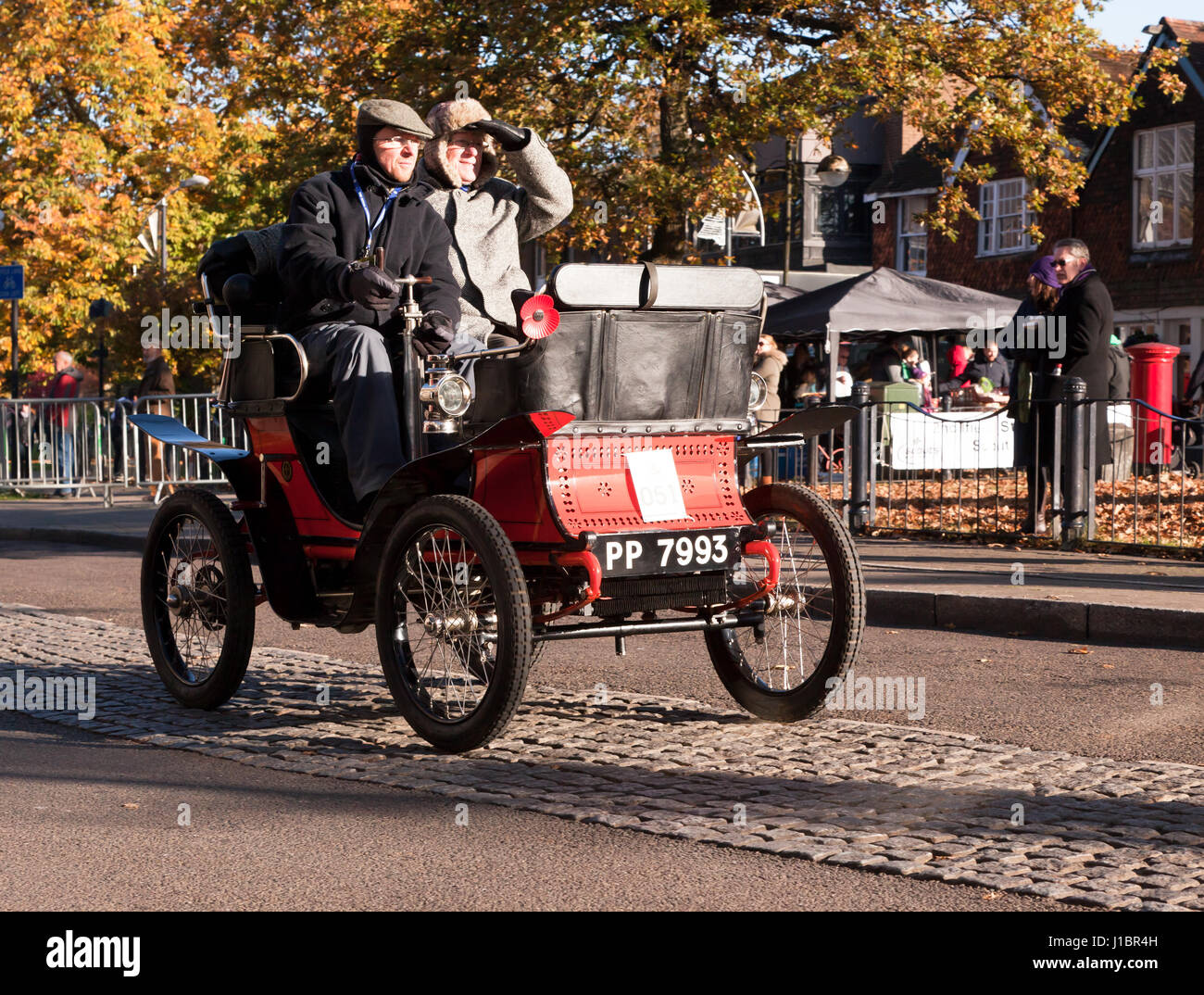 A 1900 De Dion Bouton, Driven by Mr Simeon Barringer, passes through Crawley High Street, during the 2016 London - Stock Image