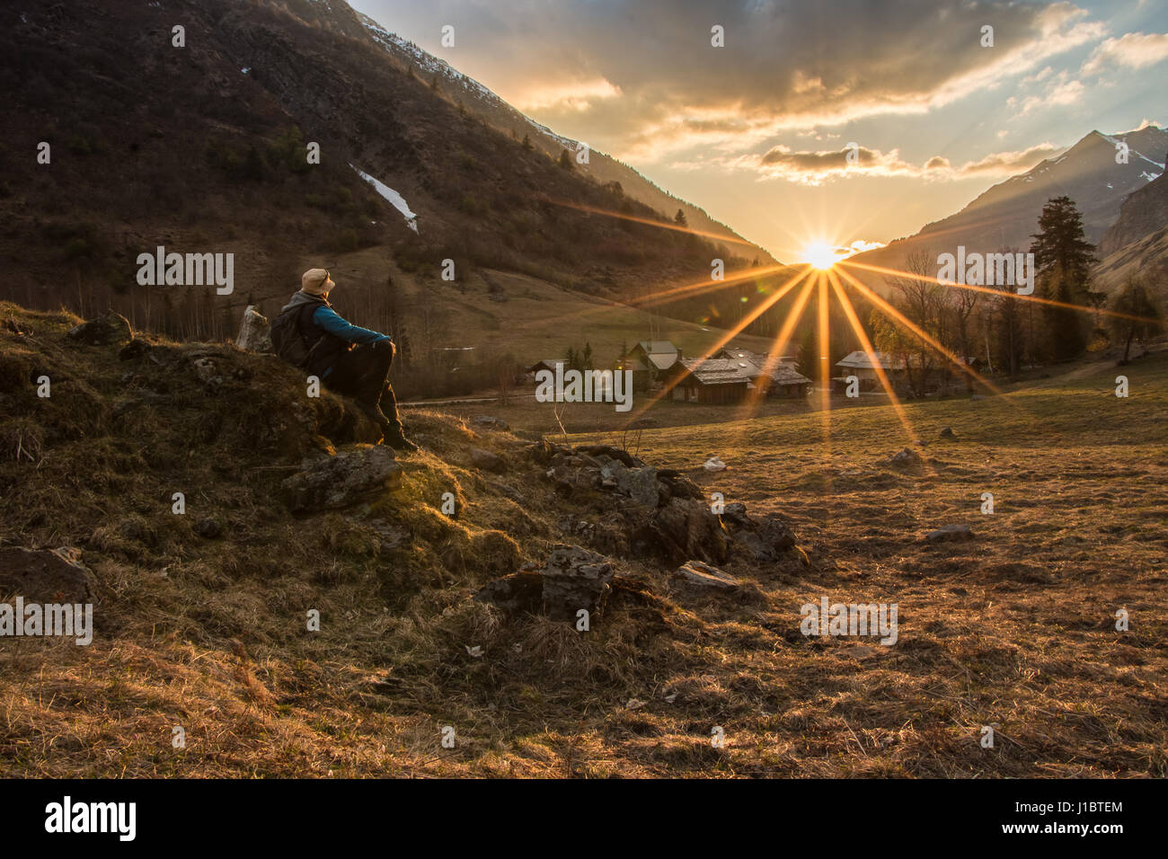 Adminring the sunset in the mountains a man hiking in the alps hikers landscape sunsets adventure outdoors lifestyle - Stock Image