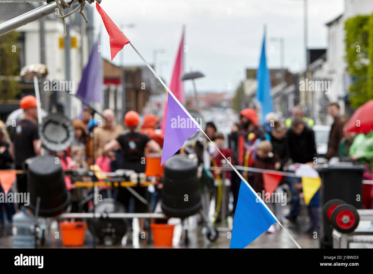 wet plastic bunting outdoors on a wet outdoor event in the uk - Stock Image