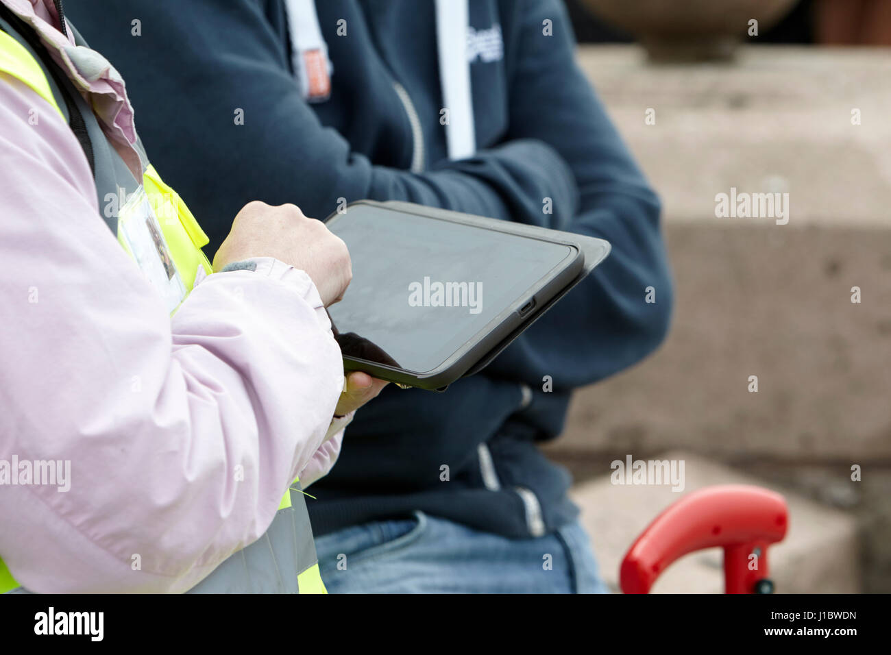 using ipad tablet to conduct street questionnaire survey - Stock Image