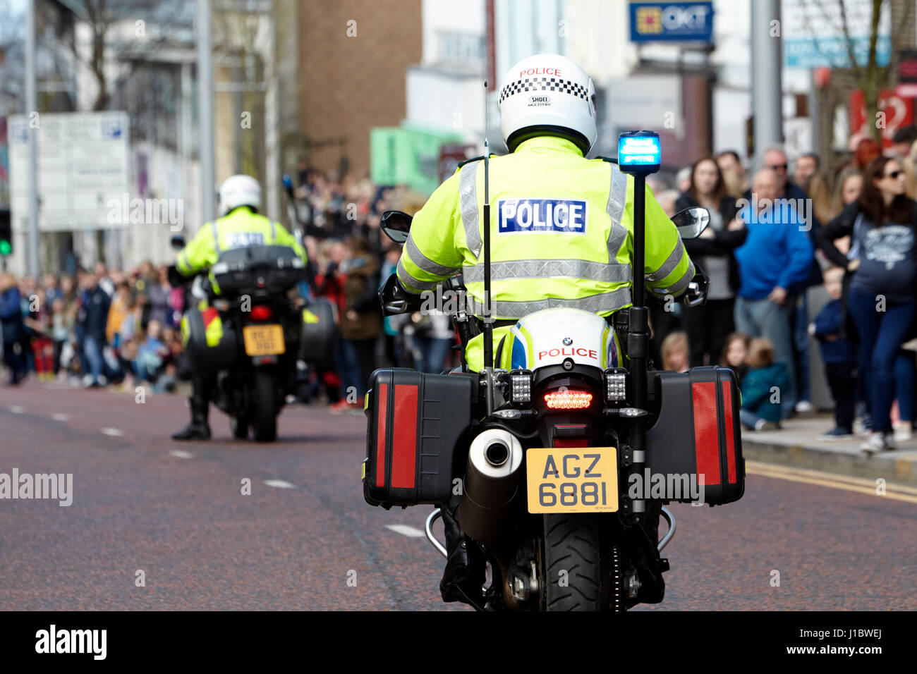 psni police officer traffic police on bmw motorbike during a parade in northern ireland Stock Photo