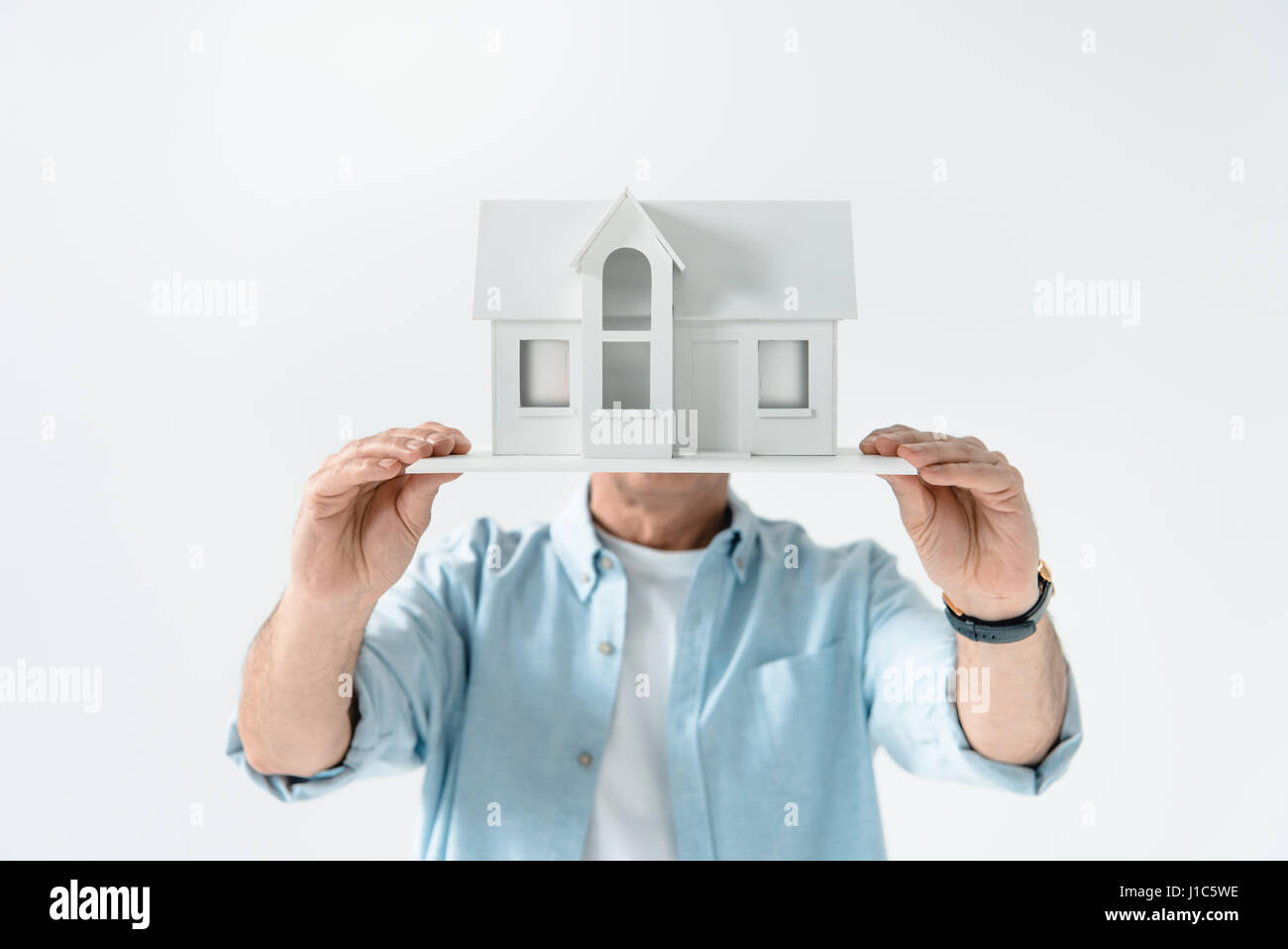 obscure view of man showing house model on white Stock Photo