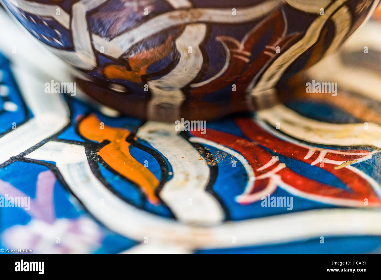 A cup of pour over coffee sits on a hand painted coffee table in a shop - Stock Image