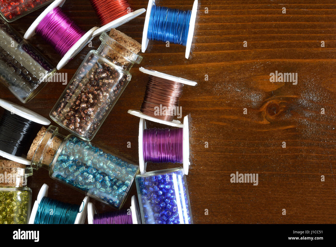 Mini glass bottles with beads and wire crafts - Stock Image