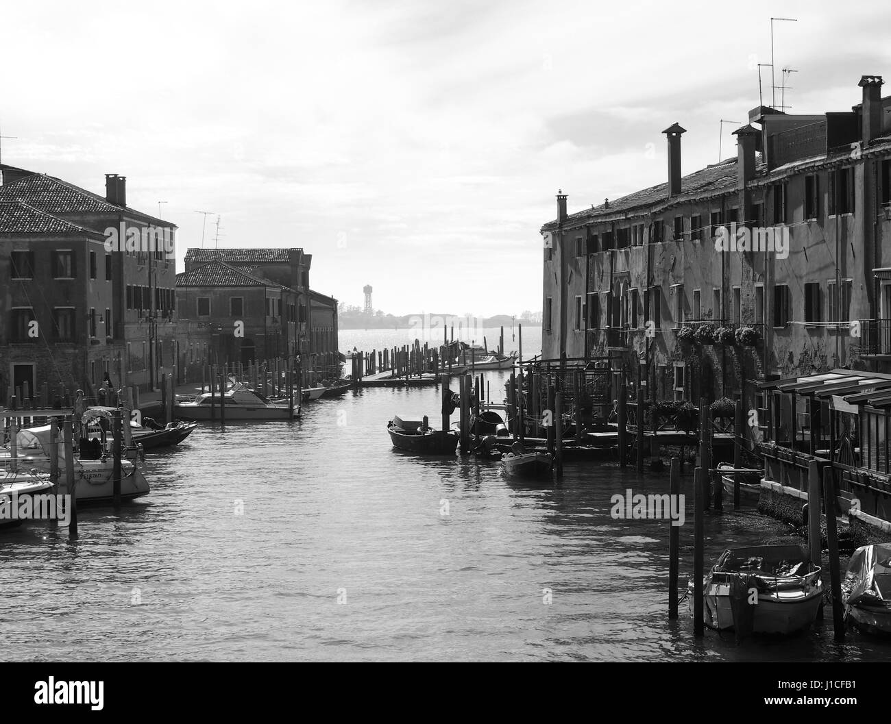 old buildings boats and canal in guidecca in venice - Stock Image