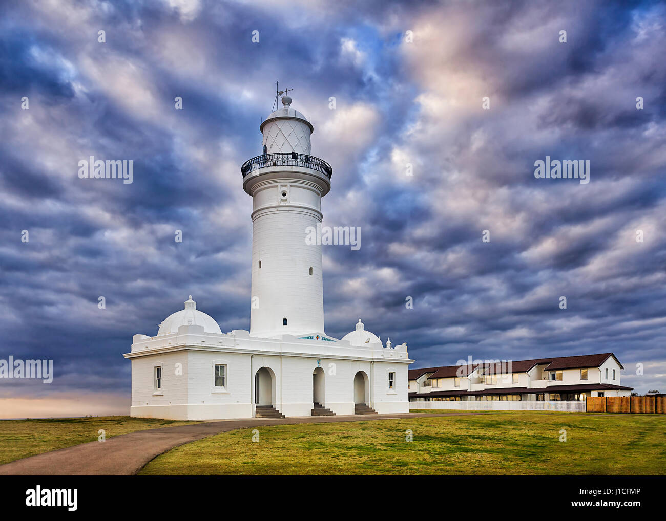 WHite historic MacQuarie lighthouse on Sydney's South head Watsons bay suburb on a cloudy morning. - Stock Image