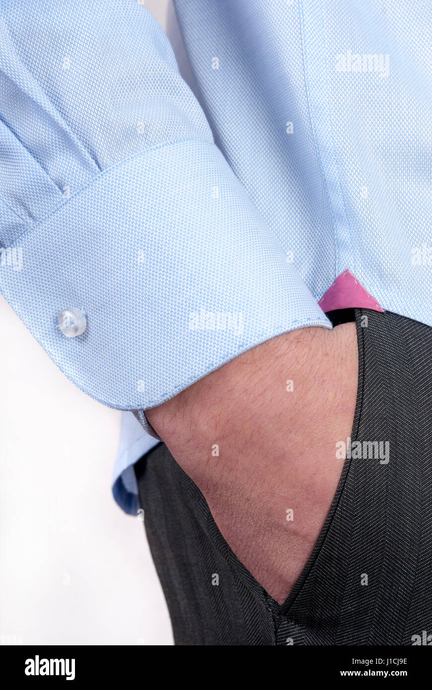 The man's hand in the pants pocket  close-up Stock Photo